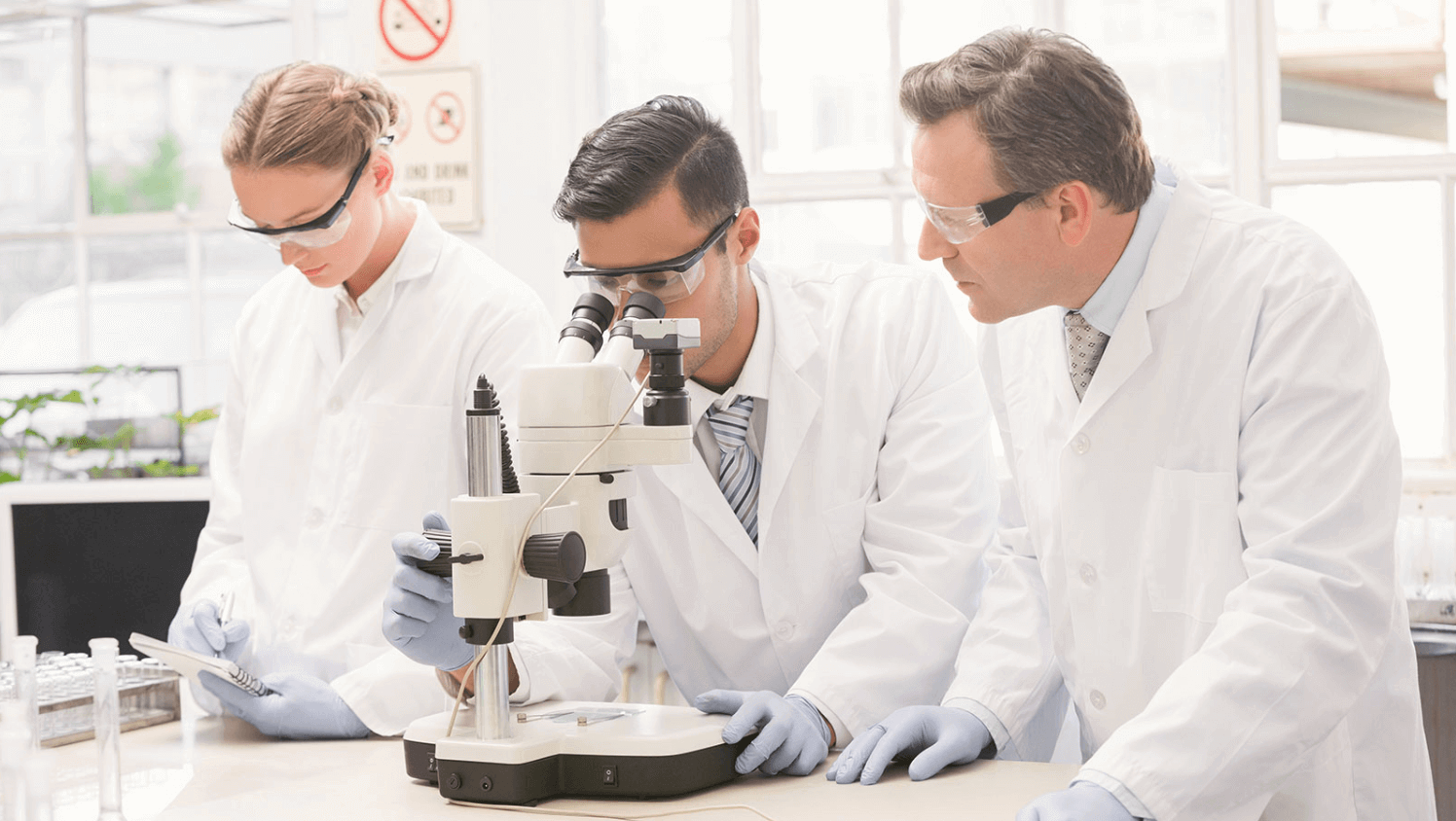 Healthcare proffesionals looking into a microscope